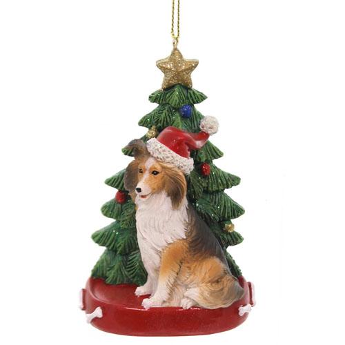 Figurine dog seating near Christmas tree